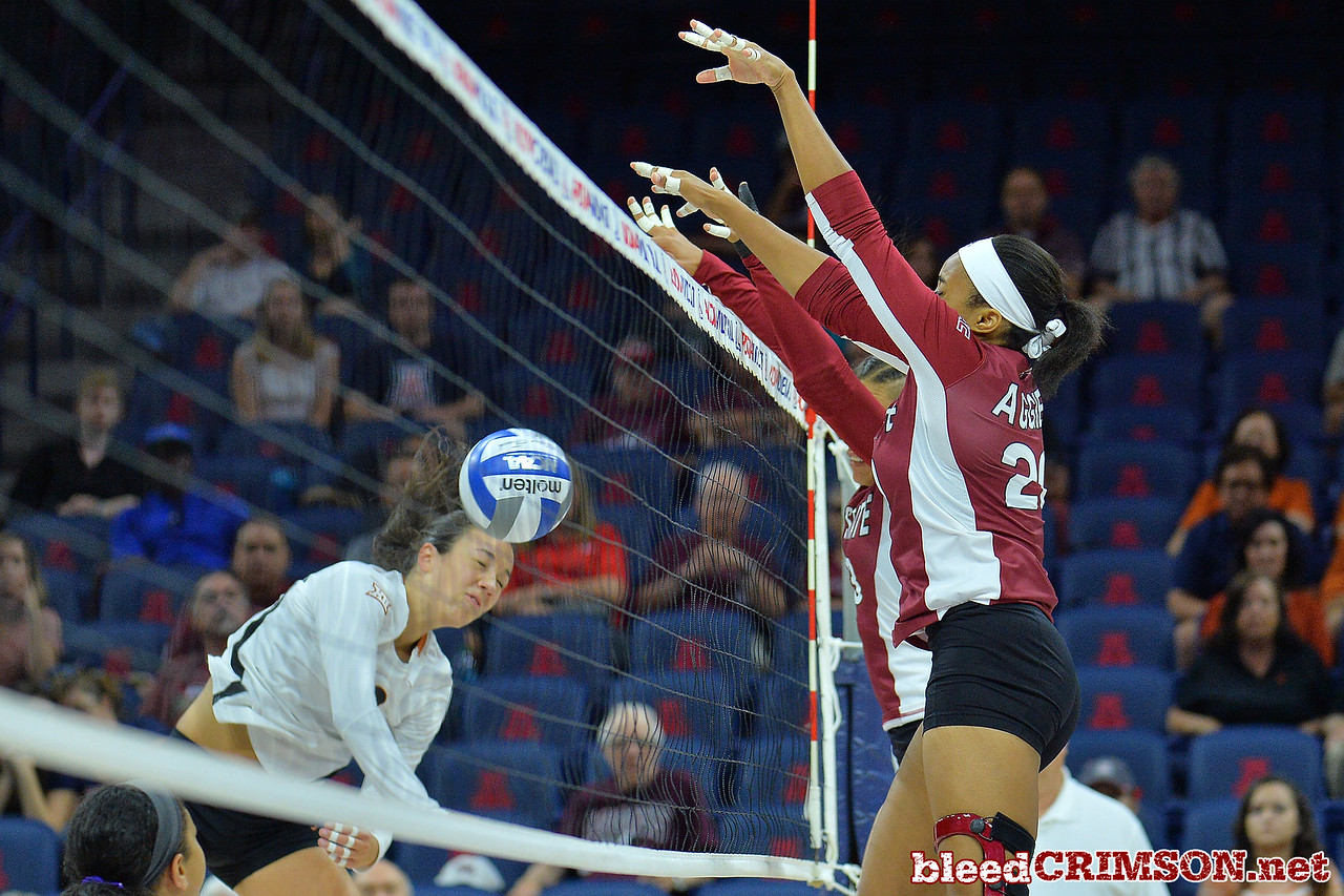 September 19, 2015: Nathalie Castellanos and Sasha-Lee Thomas block an attack from Texas outside hitter Amy Neal (9) in a match between New Mexico State and No. 2 Texas at McKale Memorial Center in Tucson, Ariz.