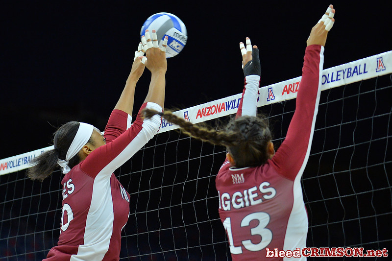 September 19, 2015: Sasha-Lee Thomas block a ball in a match between New Mexico State and No. 2 Texas at McKale Memorial Center in Tucson, Ariz.