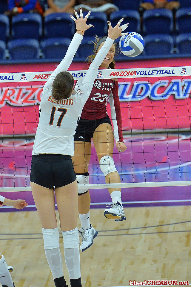 September 19, 2015: Gwen Murphy beats Texas middle blocker Mirta Baselovic (17) for a kill in a match between New Mexico State and No. 2 Texas at McKale Memorial Center in Tucson, Ariz.