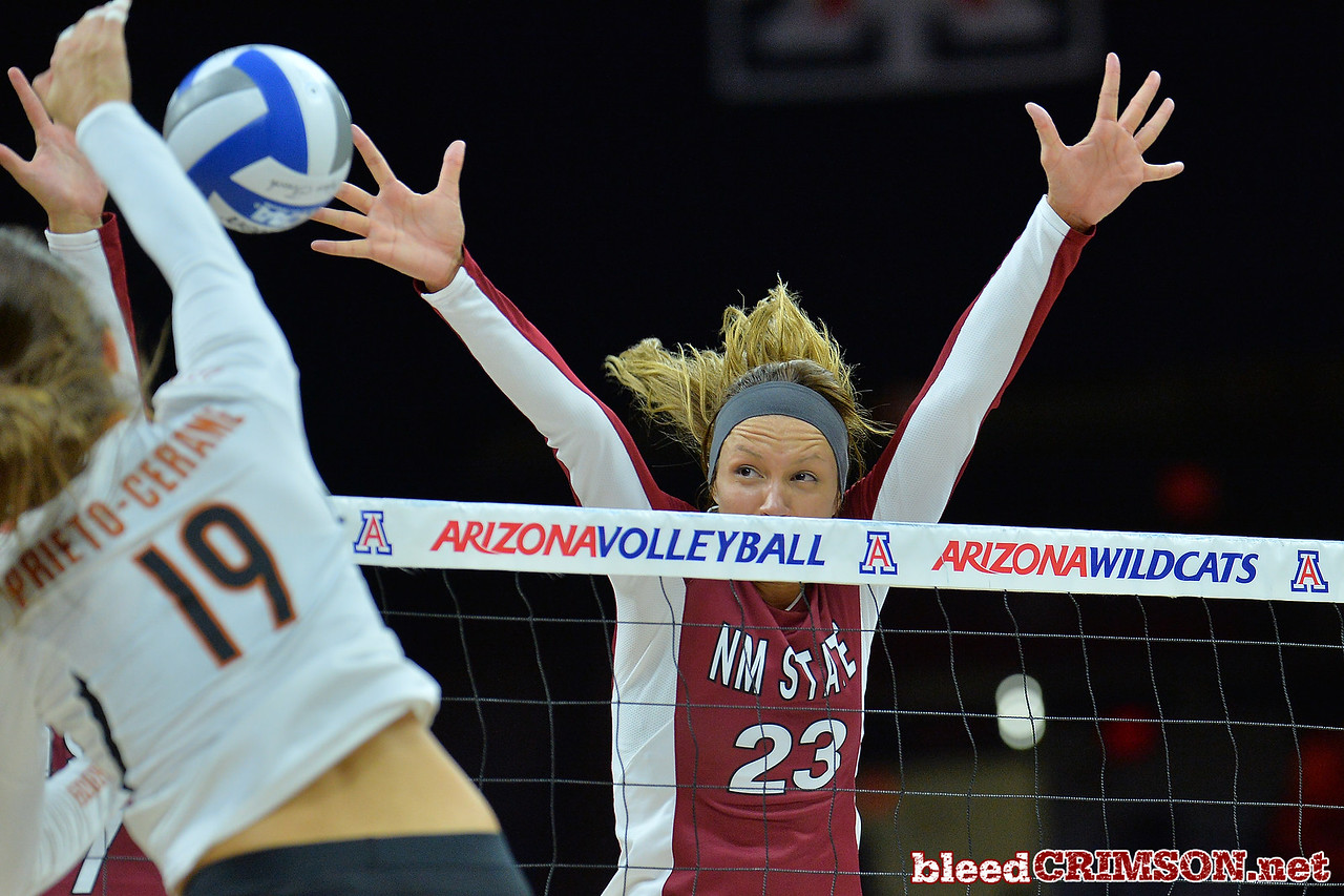 September 19, 2015: Gwen Murphy blocks an attack from Texas outside hitter Paulina Prieto Cerame (19) in a match between New Mexico State and No. 2 Texas at McKale Memorial Center in Tucson, Ariz.