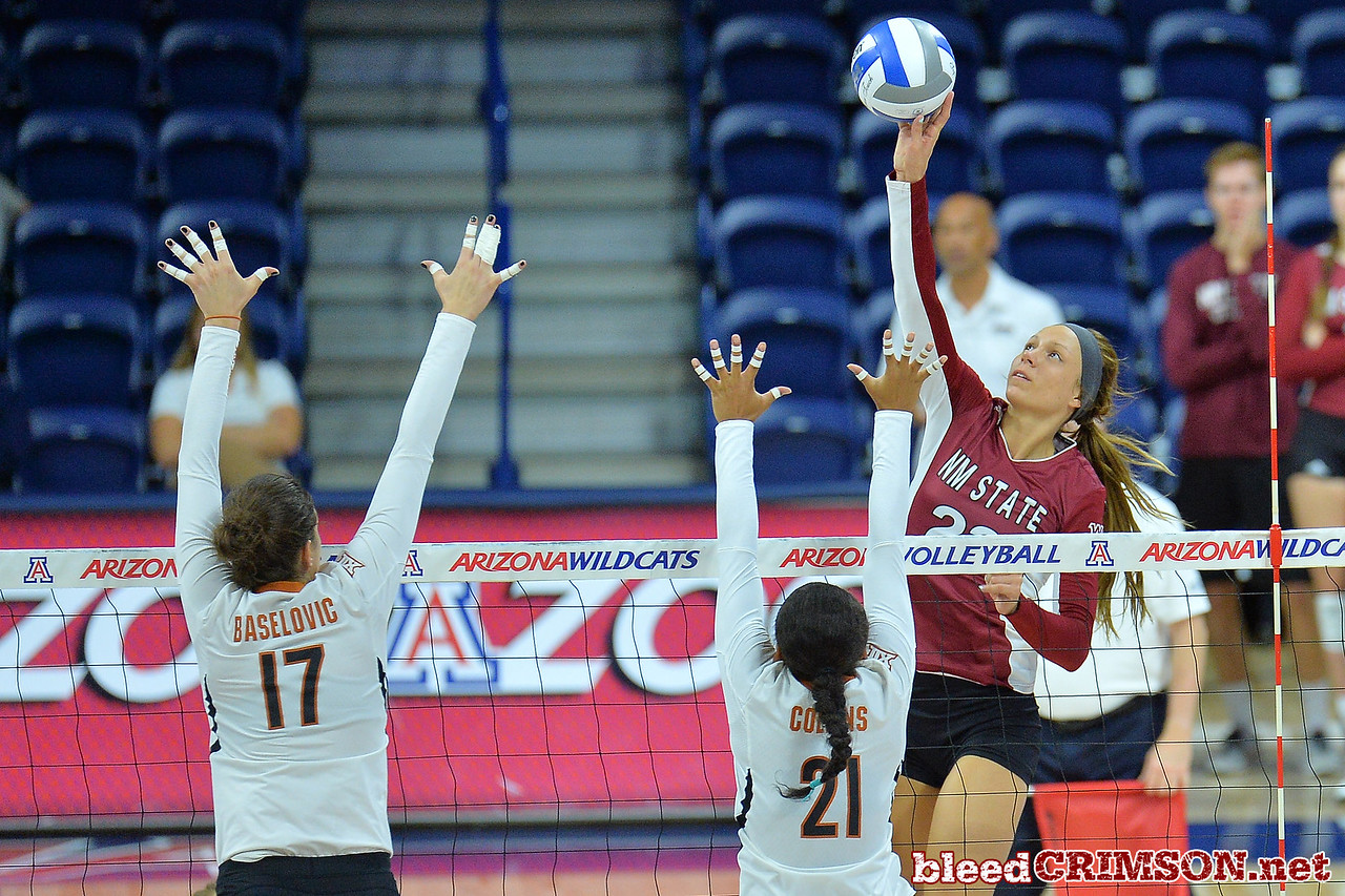 September 19, 2015: Gwen Murphy tips a ball over the Texas block in a match between New Mexico State and No. 2 Texas at McKale Memorial Center in Tucson, Ariz.