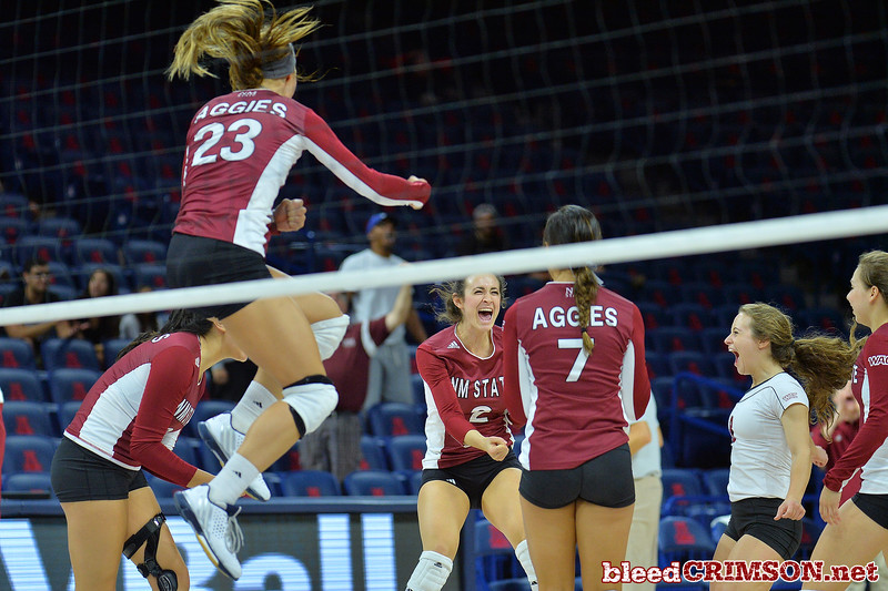 September 19, 2015: The Aggies celebrate after taking set two 27-25 in a match between New Mexico State and No. 2 Texas at McKale Memorial Center in Tucson, Ariz.