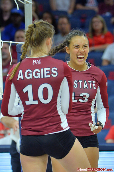 September 19, 2015: Nathalie Castellanos celebrates a point in a match between New Mexico State and No. 2 Texas at McKale Memorial Center in Tucson, Ariz.