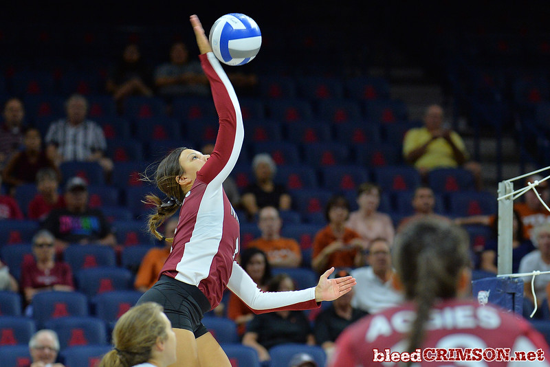 September 19, 2015: Jordan Abalos takes a swing in a match between New Mexico State and No. 2 Texas at McKale Memorial Center in Tucson, Ariz.