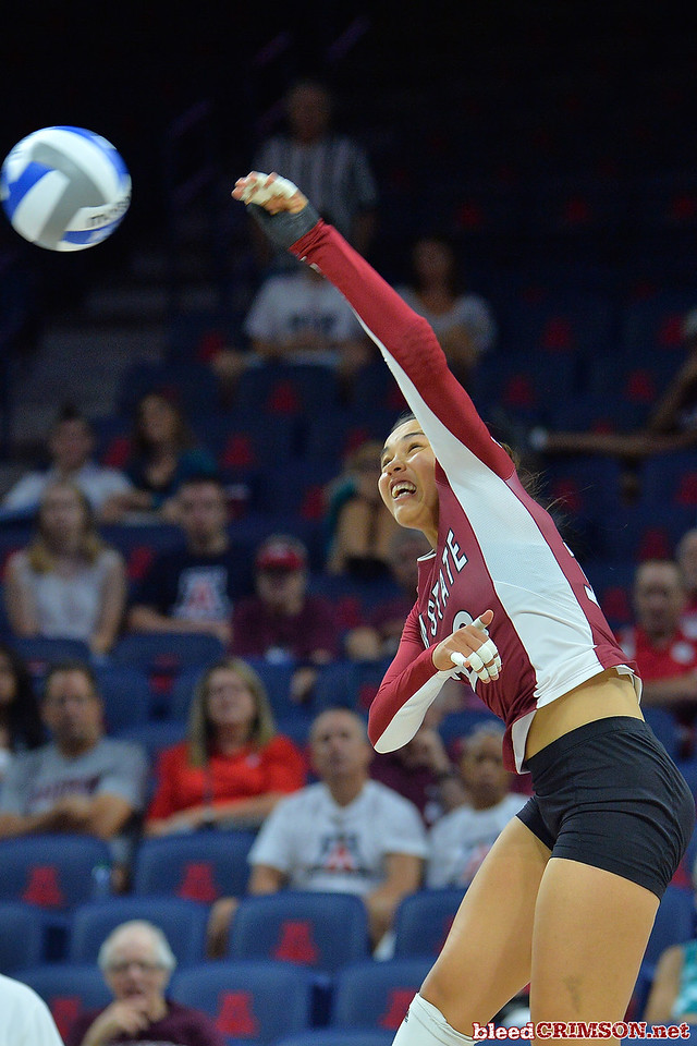 September 19, 2015: Nathalie Castellanos takes a swing in a match between New Mexico State and No. 2 Texas at McKale Memorial Center in Tucson, Ariz.