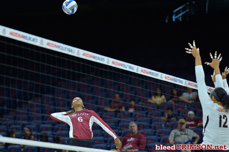 September 19, 2015: Tatyana Battle takes a swing in a match between New Mexico State and No. 2 Texas at McKale Memorial Center in Tucson, Ariz.