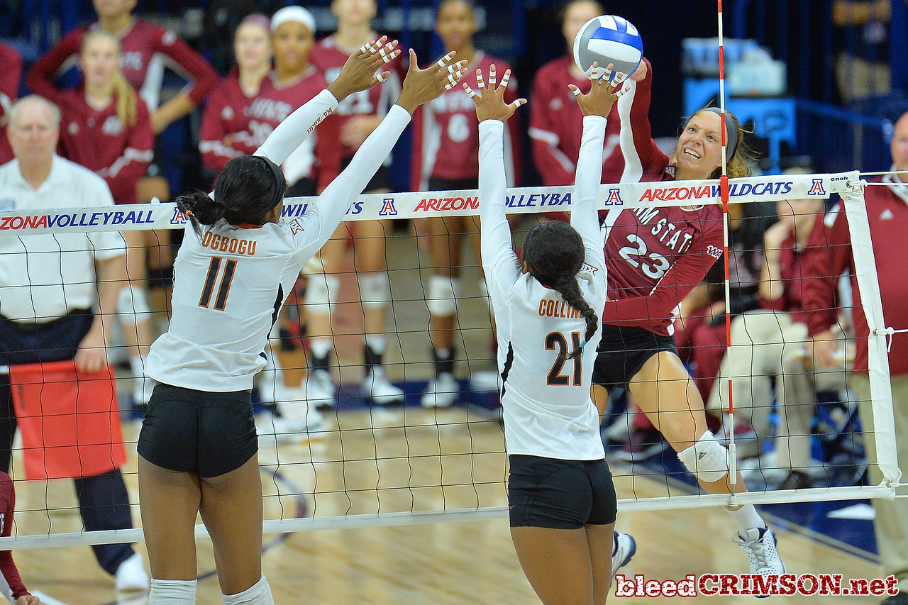 September 19, 2015: Gwen Murphy sends a ball past the block of Texas middle blocker Chiaka Ogbogu (11) and Texas setter Chloe Collins (21) in a match between New Mexico State and No. 2 Texas at McKale Memorial Center in Tucson, Ariz.