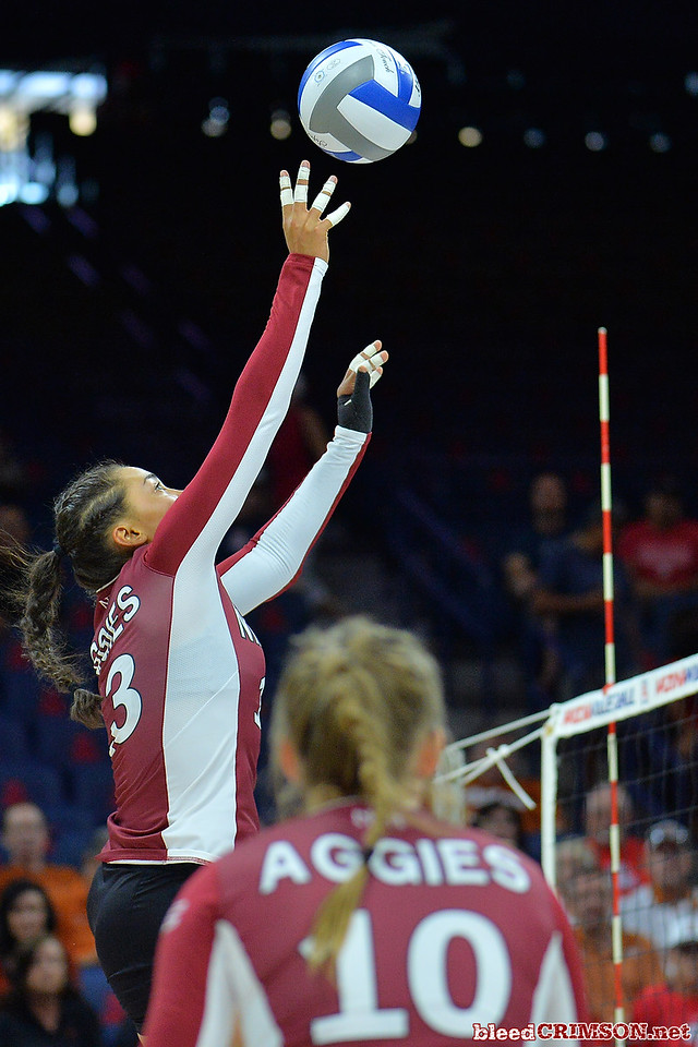 September 19, 2015: Nathalie Castellanos tips a ball over the net in a match between New Mexico State and No. 2 Texas at McKale Memorial Center in Tucson, Ariz.