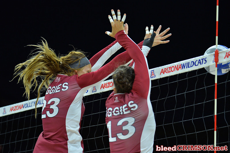 September 19, 2015: Gwen Murphy and New Mexico State Aggies linebacker Clint Barnard (13) block a ball in a match between New Mexico State and No. 2 Texas at McKale Memorial Center in Tucson, Ariz.