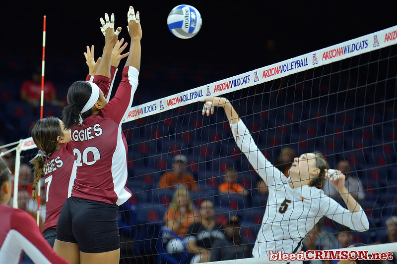 September 19, 2015: Jordan Abalos and Sasha-Lee Thomas go up for a block against Texas middle blocker Molly McCage (5) in a match between New Mexico State and No. 2 Texas at McKale Memorial Center in Tucson, Ariz.