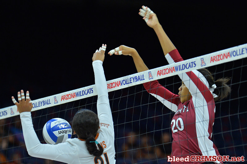 September 19, 2015: Sasha-Lee Thomas blocks a ball in a match between New Mexico State and No. 2 Texas at McKale Memorial Center in Tucson, Ariz.