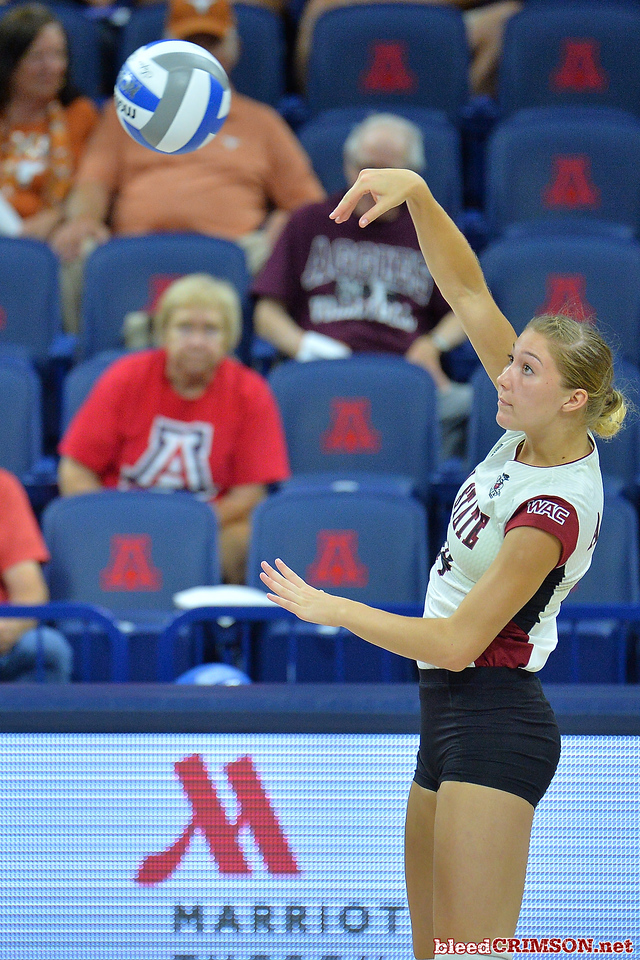 September 18, 2015: Kassandra Tohm takes a swing in a match between New Mexico State and Savannah State at McKale Memorial Center in Tucson, Ariz.