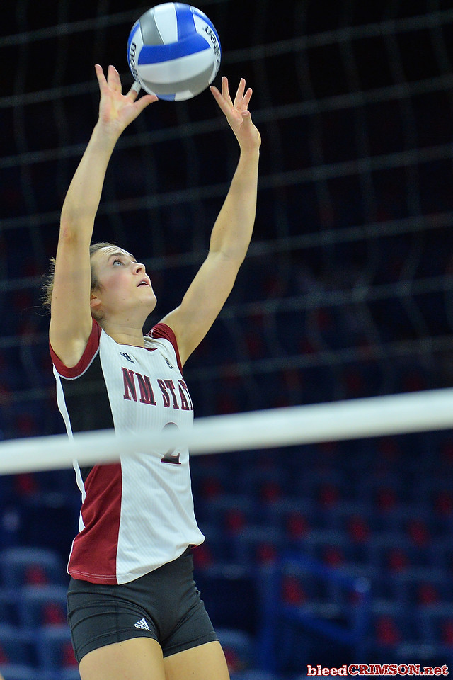 September 18, 2015: Taylor Livoti sets a ball in a match between New Mexico State and Savannah State at McKale Memorial Center in Tucson, Ariz.