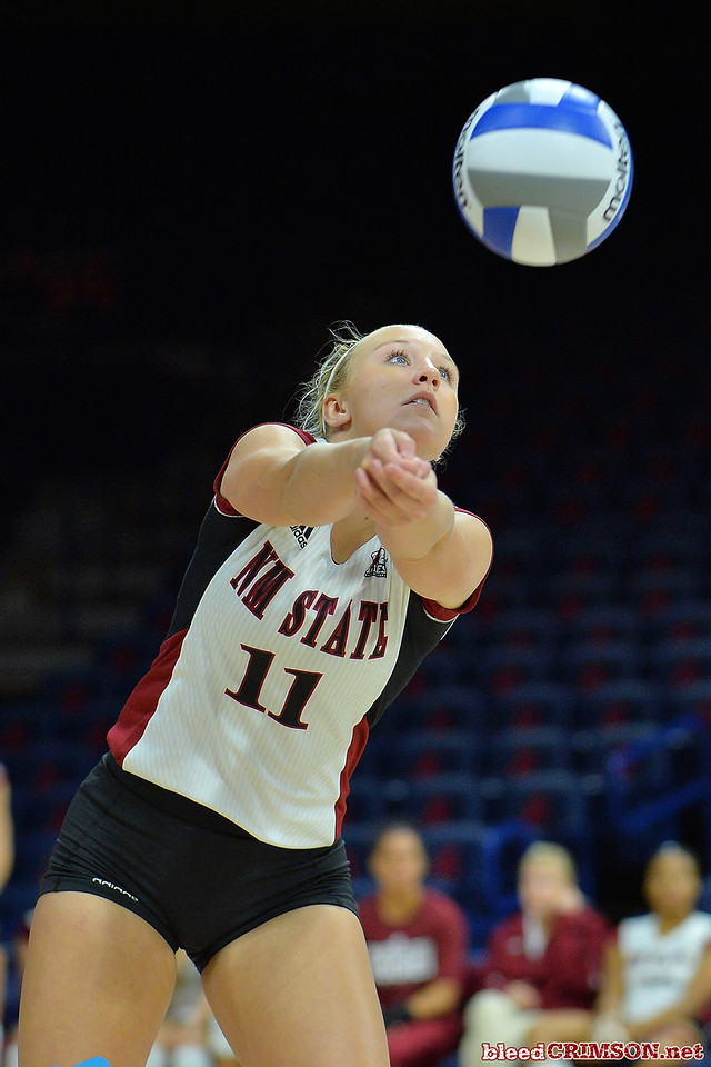 September 18, 2015: Megan McGuire digs a ball in a match between New Mexico State and Savannah State at McKale Memorial Center in Tucson, Ariz.