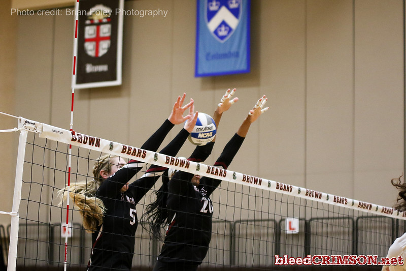 New Mexico St. middle hitter Sasha-Lee Thomas (20) New Mexico St. outside hitter Brigette Lowe (5)