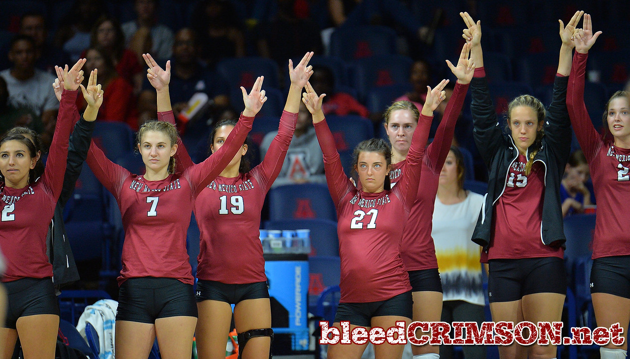 TUCSON, AZ - SEPTEMBER 15:  The New Mexico State Aggies bench holds up their fingers on set point in a match between the New Mexico State Aggies and the Arizona Wildcats at the McKale Center in Tucson, Arizona. The Wildcats won 3-2.  (Photo by Sam Wasson)