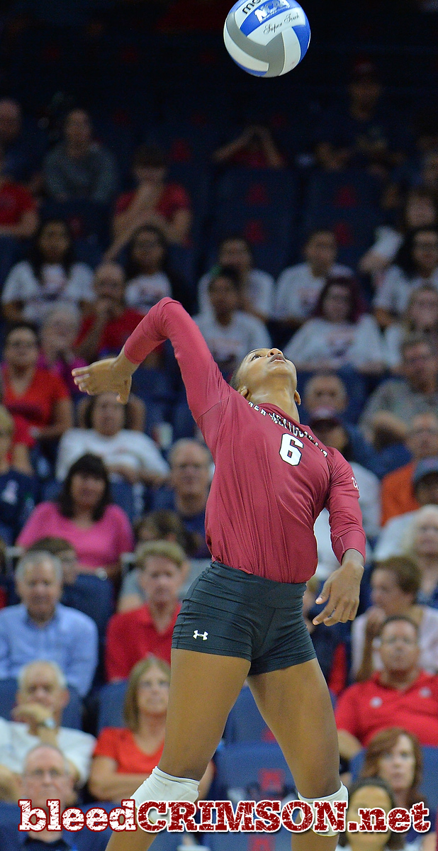 TUCSON, AZ - SEPTEMBER 15:  Tatyana Battle #6 of the New Mexico State Aggies takes a swing in a match between the New Mexico State Aggies and the Arizona Wildcats at the McKale Center in Tucson, Arizona. The Wildcats won 3-2.  (Photo by Sam Wasson)