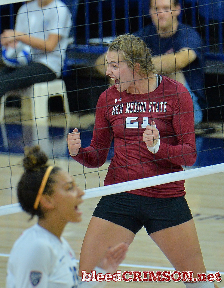 TUCSON, AZ - SEPTEMBER 15:  Lia Mosher #21 of the New Mexico State Aggies celebrates after her team wins a point in a match between the New Mexico State Aggies and the Arizona Wildcats at the McKale Center in Tucson, Arizona. The Wildcats won 3-2.  (Photo by Sam Wasson)