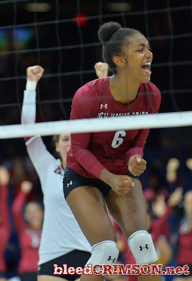 TUCSON, AZ - SEPTEMBER 15:  Tatyana Battle #6 of the New Mexico State Aggies celebrates after her team wins the second set in a match between the New Mexico State Aggies and the Arizona Wildcats at the McKale Center in Tucson, Arizona. The Wildcats won 3-2.  (Photo by Sam Wasson)
