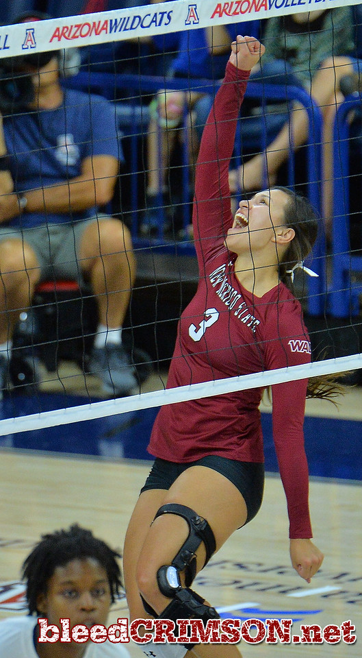 TUCSON, AZ - SEPTEMBER 15:  Jordan Abalos #3 of the New Mexico State Aggies celebrates after her team wins a point in a match between the New Mexico State Aggies and the Arizona Wildcats at the McKale Center in Tucson, Arizona. The Wildcats won 3-2.  (Photo by Sam Wasson)
