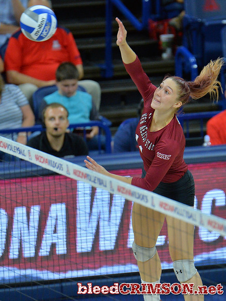 TUCSON, AZ - SEPTEMBER 15:  Kassandra Tohm #14 of the New Mexico State Aggies takes a swing in a match between the New Mexico State Aggies and the Arizona Wildcats at the McKale Center in Tucson, Arizona. The Wildcats won 3-2.  (Photo by Sam Wasson)