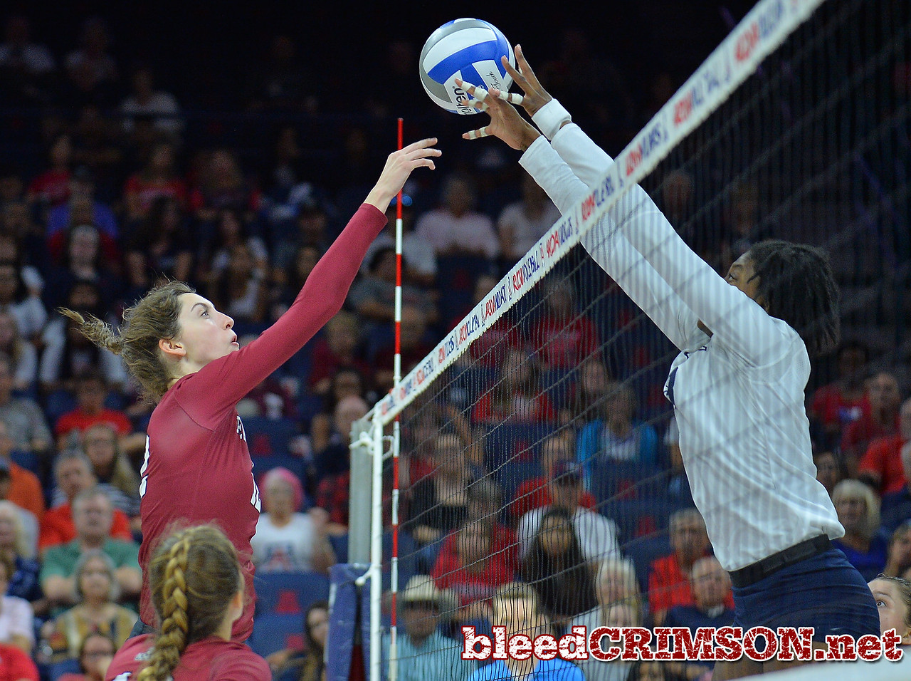 TUCSON, AZ - SEPTEMBER 15:  Megan Hart #12 of the New Mexico State Aggies sends a ball past the block in a match between the New Mexico State Aggies and the Arizona Wildcats at the McKale Center in Tucson, Arizona. The Wildcats won 3-2.  (Photo by Sam Wasson)