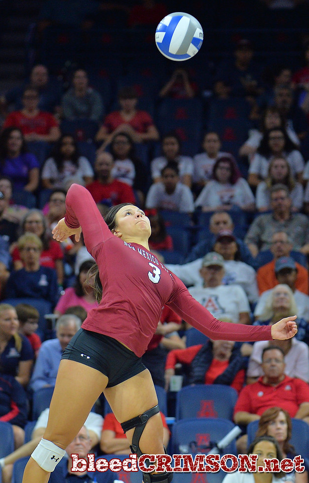 TUCSON, AZ - SEPTEMBER 15:  Jordan Abalos #3 of the New Mexico State Aggies takes a swing in a match between the New Mexico State Aggies and the Arizona Wildcats at the McKale Center in Tucson, Arizona. The Wildcats won 3-2.  (Photo by Sam Wasson)