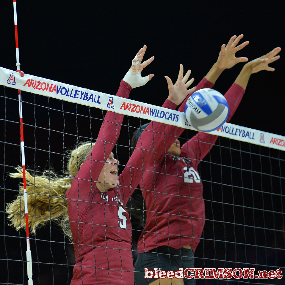TUCSON, AZ - SEPTEMBER 15:  Brigette Lowe #5 and Sasha-Lee Thomas #20 of the New Mexico State Aggies go up for a block in a match between the New Mexico State Aggies and the Arizona Wildcats at the McKale Center in Tucson, Arizona. The Wildcats won 3-2.  (Photo by Sam Wasson)
