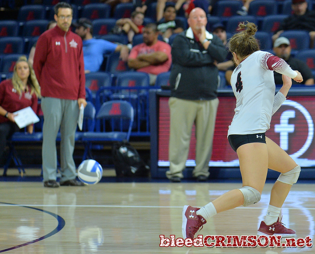 TUCSON, AZ - SEPTEMBER 15:  Ariadnne Sierra #4 of the New Mexico State Aggies watches as a ball lands just inside the line in a match between the New Mexico State Aggies and the Arizona Wildcats at the McKale Center in Tucson, Arizona. The Wildcats won 3-2.  (Photo by Sam Wasson)