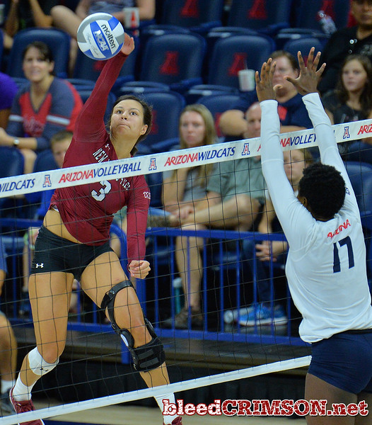 TUCSON, AZ - SEPTEMBER 15:  Jordan Abalos #3 of the New Mexico State Aggies takes a swing against Elizabeth Shelton #17 of the Arizona Wildcats in a match between the New Mexico State Aggies and the Arizona Wildcats at the McKale Center in Tucson, Arizona. The Wildcats won 3-2.  (Photo by Sam Wasson)