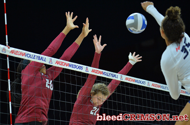 TUCSON, AZ - SEPTEMBER 15:  Sasha-Lee Thomas #20 and Lia Mosher #21 of the New Mexico State Aggies go up for a block against Tyler Spriggs #35 of the Arizona Wildcats in a match between the New Mexico State Aggies and the Arizona Wildcats at the McKale Center in Tucson, Arizona. The Wildcats won 3-2.  (Photo by Sam Wasson)