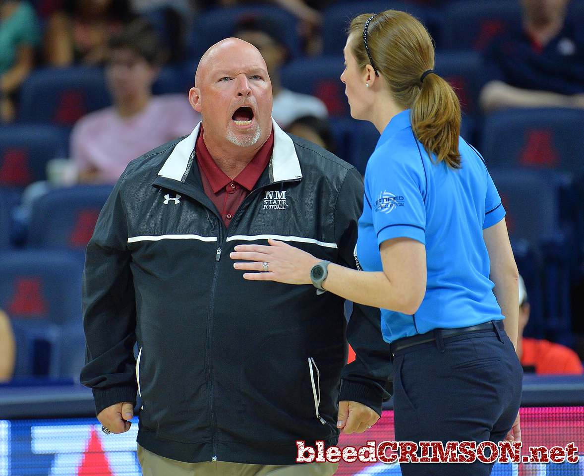 TUCSON, AZ - SEPTEMBER 15:  Head coach Mike Jordan of the New Mexico State Aggies shouts angrily at the up official after a missed call in a match between the New Mexico State Aggies and the Arizona Wildcats at the McKale Center in Tucson, Arizona. The Wildcats won 3-2.  (Photo by Sam Wasson)