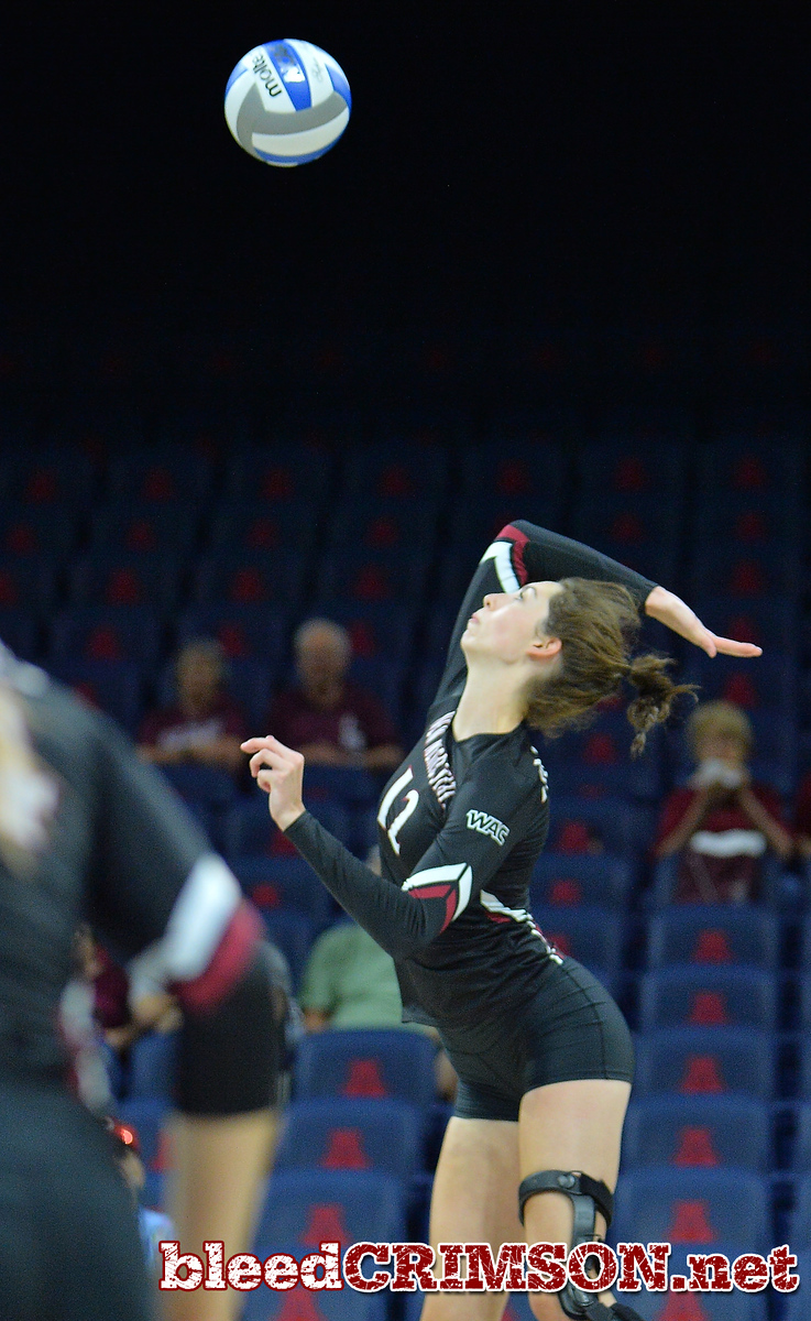 TUCSON, AZ - SEPTEMBER 16:  Megan Hart #12 of the New Mexico State Aggies takes a swing in a match between the New Mexico State Aggies and the Illinois State Redbirds at the McKale Center in Tucson, Arizona. The Redbirds won 3-0.  (Photo by Sam Wasson)