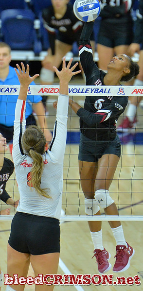 TUCSON, AZ - SEPTEMBER 16:  Tatyana Battle #6 of the New Mexico State Aggies takes a swing against Stef Jankiewicz #9 of the Illinois State Redbirds in a match between the New Mexico State Aggies and the Illinois State Redbirds at the McKale Center in Tucson, Arizona. The Redbirds won 3-0.  (Photo by Sam Wasson)