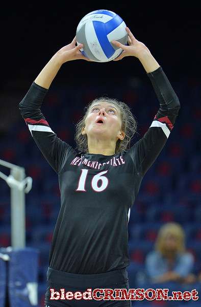 TUCSON, AZ - SEPTEMBER 16:  Natalie Mikels #16 of the New Mexico State Aggies sets a ball in a match between the New Mexico State Aggies and the Illinois State Redbirds at the McKale Center in Tucson, Arizona. The Redbirds won 3-0.  (Photo by Sam Wasson)