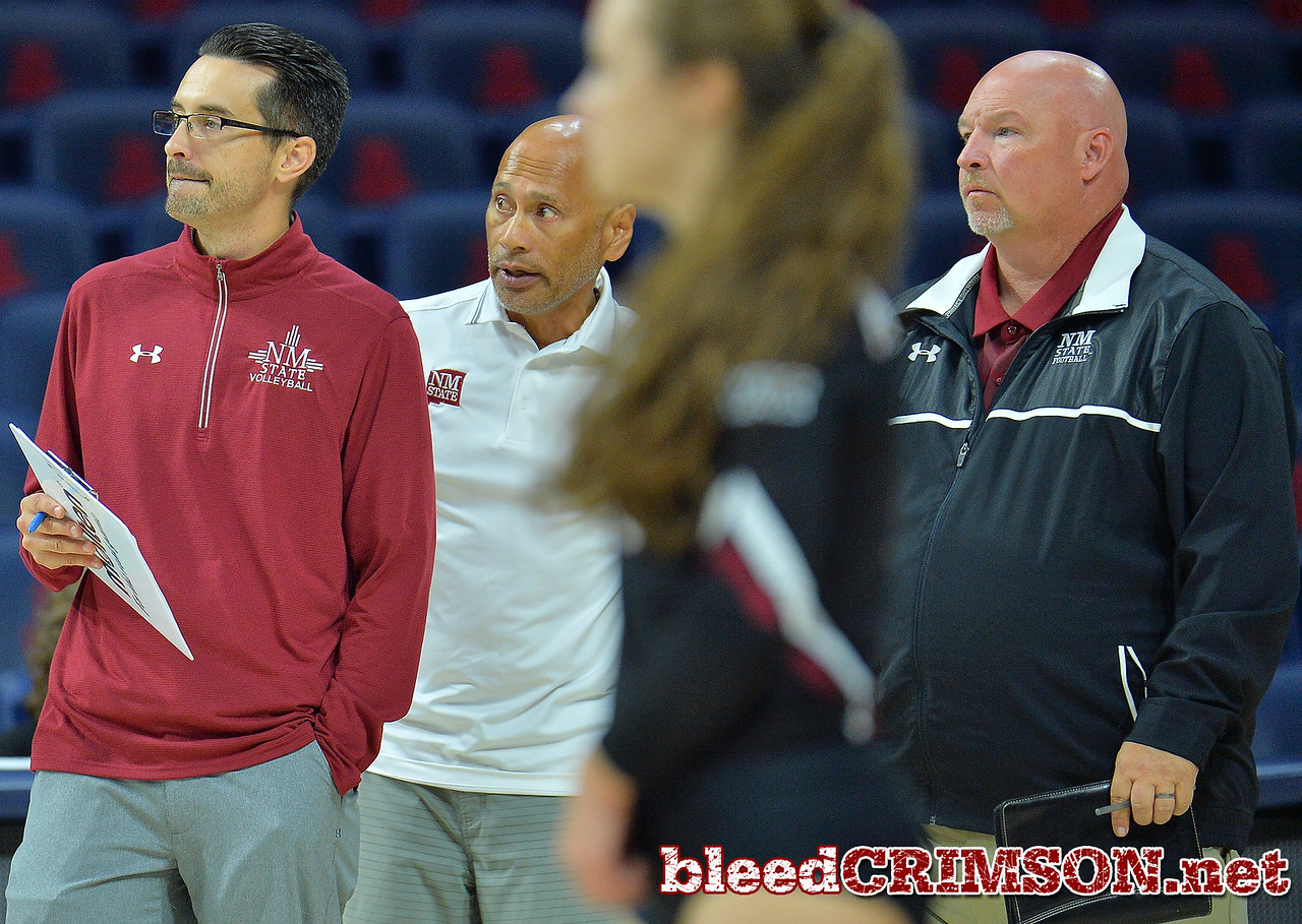 TUCSON, AZ - SEPTEMBER 16:  (L-R) Associate head coach Ben Wallis, associate head coach Keith Rubio and head coach Mike Jordan look on in a match between the New Mexico State Aggies and the Illinois State Redbirds at the McKale Center in Tucson, Arizona. The Redbirds won 3-0.  (Photo by Sam Wasson)