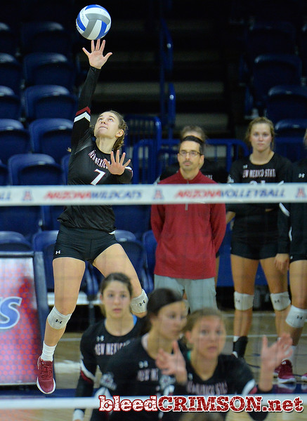 TUCSON, AZ - SEPTEMBER 16:  Kiley Tonge #7 of the New Mexico State Aggies serves a ball in a match between the New Mexico State Aggies and the Illinois State Redbirds at the McKale Center in Tucson, Arizona. The Redbirds won 3-0.  (Photo by Sam Wasson)