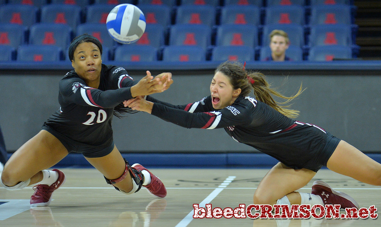 TUCSON, AZ - SEPTEMBER 16:  Sasha-Lee Thomas #20 and Briana Ainsworth #1 of the New Mexico State Aggies dive for a ball in a match between the New Mexico State Aggies and the Illinois State Redbirds at the McKale Center in Tucson, Arizona. The Redbirds won 3-0.  (Photo by Sam Wasson)
