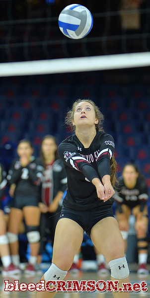 TUCSON, AZ - SEPTEMBER 16:  Kaylee Neal #8 of the New Mexico State Aggies digs a ball in a match between the New Mexico State Aggies and the Illinois State Redbirds at the McKale Center in Tucson, Arizona. The Redbirds won 3-0.  (Photo by Sam Wasson)
