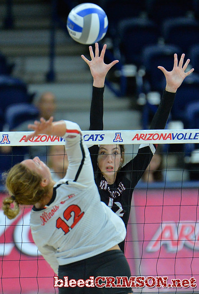 TUCSON, AZ - SEPTEMBER 16:  Megan Hart #12 of the New Mexico State Aggies goes up for a block attempt against Machayla Leonard #12 of the Illinois State Redbirds in a match between the New Mexico State Aggies and the Illinois State Redbirds at the McKale Center in Tucson, Arizona. The Redbirds won 3-0.  (Photo by Sam Wasson)