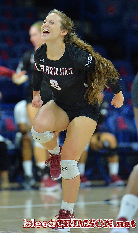 TUCSON, AZ - SEPTEMBER 16:  Kaylee Neal #8 of the New Mexico State Aggies celebrates after her team wins a point in a match between the New Mexico State Aggies and the Illinois State Redbirds at the McKale Center in Tucson, Arizona. The Redbirds won 3-0.  (Photo by Sam Wasson)