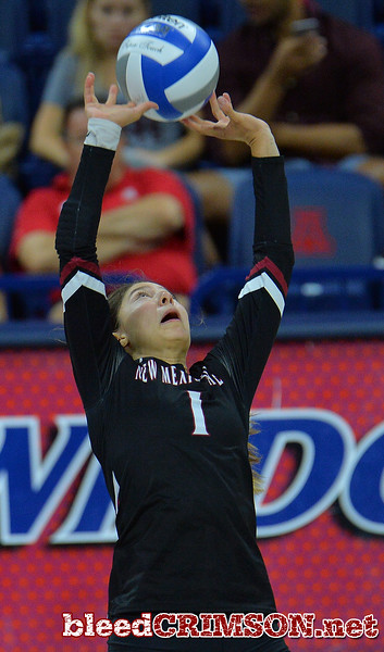 TUCSON, AZ - SEPTEMBER 16:  Briana Ainsworth #1 of the New Mexico State Aggies sets a ball in a match between the New Mexico State Aggies and the Illinois State Redbirds at the McKale Center in Tucson, Arizona. The Redbirds won 3-0.  (Photo by Sam Wasson)
