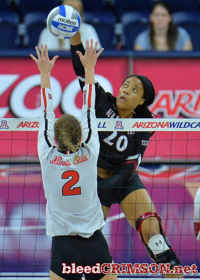 TUCSON, AZ - SEPTEMBER 16:  Sasha-Lee Thomas #20 of the New Mexico State Aggies takes a swing in a match between the New Mexico State Aggies and the Illinois State Redbirds at the McKale Center in Tucson, Arizona. The Redbirds won 3-0.  (Photo by Sam Wasson)
