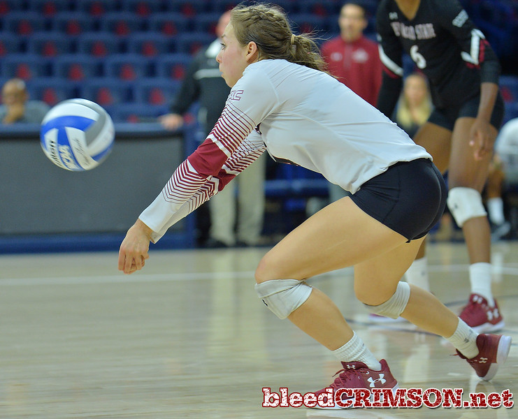 TUCSON, AZ - SEPTEMBER 16:  Ariadnne Sierra #4 of the New Mexico State Aggies digs a ball in a match between the New Mexico State Aggies and the Illinois State Redbirds at the McKale Center in Tucson, Arizona. The Redbirds won 3-0.  (Photo by Sam Wasson)