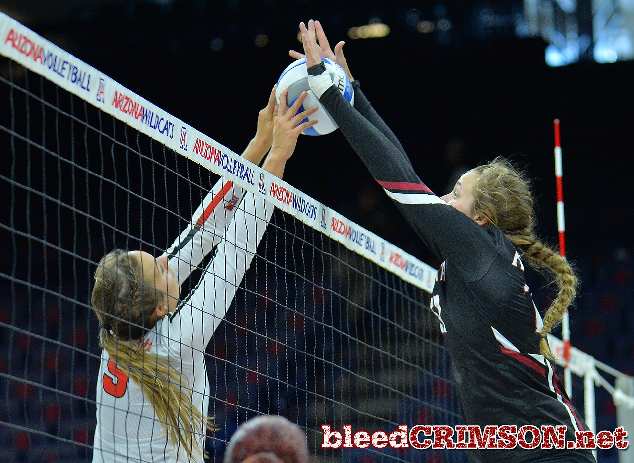 TUCSON, AZ - SEPTEMBER 16:  Lia Mosher #21 of the New Mexico State Aggies goes up for a block against Stef Jankiewicz #9 of the Illinois State Redbirds in a match between the New Mexico State Aggies and the Illinois State Redbirds at the McKale Center in Tucson, Arizona. The Redbirds won 3-0.  (Photo by Sam Wasson)