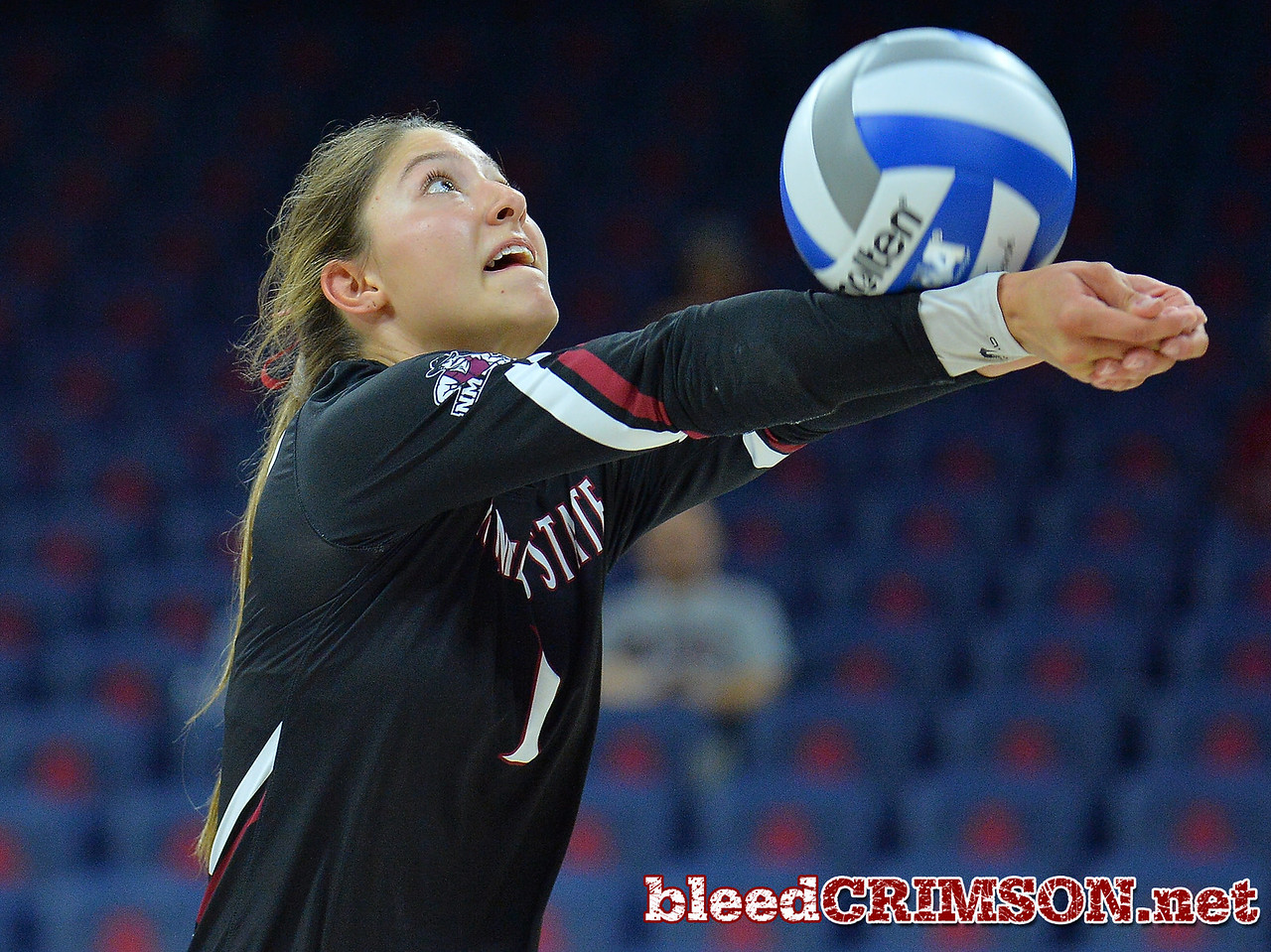 TUCSON, AZ - SEPTEMBER 16:  Briana Ainsworth #1 of the New Mexico State Aggies bump sets a ball in a match between the New Mexico State Aggies and the Illinois State Redbirds at the McKale Center in Tucson, Arizona. The Redbirds won 3-0.  (Photo by Sam Wasson)