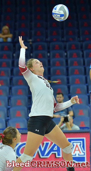 TUCSON, AZ - SEPTEMBER 16:  Lia Mosher #21 of the New Mexico State Aggies takes a swing in a match between the New Mexico State Aggies and the William & Mary Tribe at the McKale Center in Tucson, Arizona. The Aggies won 3-0.  (Photo by Sam Wasson)