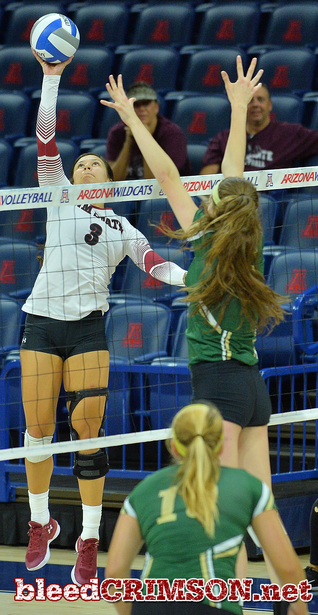 TUCSON, AZ - SEPTEMBER 16:  Jordan Abalos #3 of the New Mexico State Aggies tips a ball over the William & Mary Tribe block in a match between the New Mexico State Aggies and the William & Mary Tribe at the McKale Center in Tucson, Arizona. The Aggies won 3-0.  (Photo by Sam Wasson)