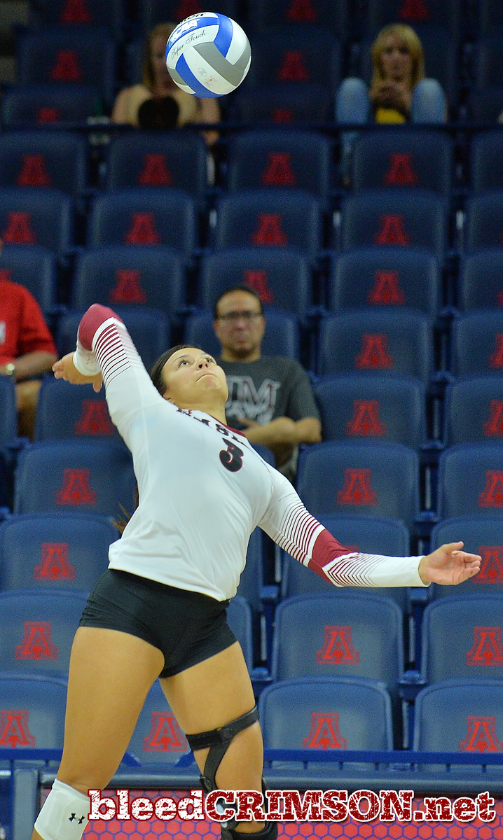 TUCSON, AZ - SEPTEMBER 16:  Jordan Abalos #3 of the New Mexico State Aggies takes a swing in a match between the New Mexico State Aggies and the William & Mary Tribe at the McKale Center in Tucson, Arizona. The Aggies won 3-0.  (Photo by Sam Wasson)