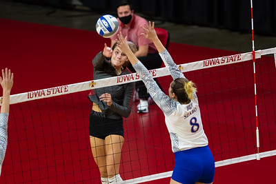 Acion from NCAA volleyball match between the Kansas Jayhawks and the Iowa  State Cyclones at Hilton Coliseum in Ames, Iowa on November 14, 2020. Photo © Wesley Winterink.